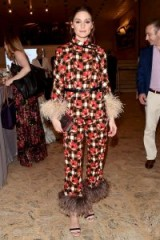Olivia Palermo attends the New York City Ballet 2018 Spring Gala, dressed in a Prada feather trimmed pyjama top and matching trousers