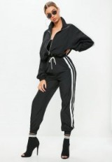 Missguided black double side stripe track shell suit trousers | sporty cuffed pants