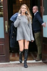 Blake Lively street style…grey oversized jumper, worn as a dress, long black combat boots, blue fur coat and statement earrings.