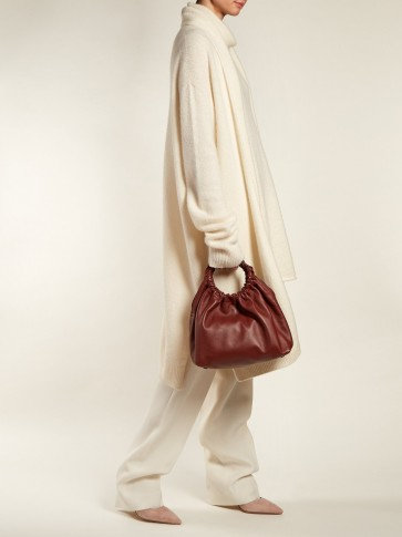 THE ROW Circle-handle leather bag / chic burgundy handbag