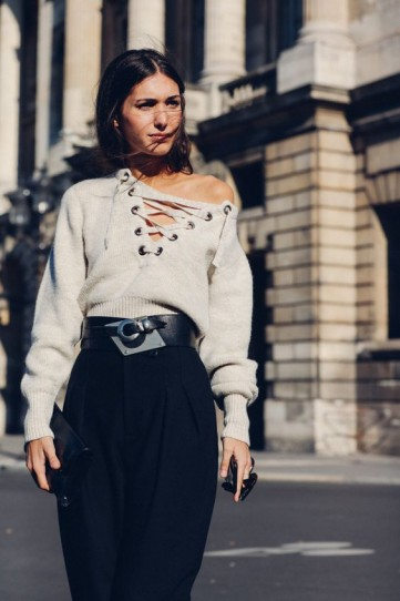 Stylish knitwear, black pants and a statement belt = chic look