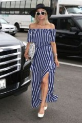 Paris Hilton at LAX Airport dressed in a navy and white striped bardot maxi dress May 2018 – celebrity summer style outfits
