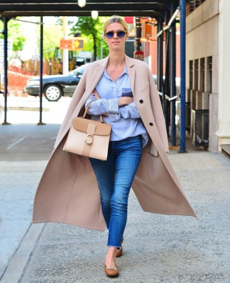 Nicky Hilton street style in skinny jeans, blue shirt, beige tailored coat and neutral colour-block handbag – chic celebrity outfits