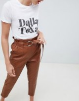 River Island peg trousers in faux leather in tan | brown tapered crop leg pants