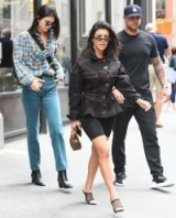 Kourtney Kardashian black net heels, YEEZY mesh panel mules, out with sister Kendall in New York, 5 June 2018. Celebrity shoes | street style footwear