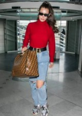 Bella Hadid large brown logo bag, FENDI Runaway Shopper tote, at Charles De Gaulle Airport in Paris, 2 June 2018. Celebrity handbags | models off duty accessories | celebrity travel style