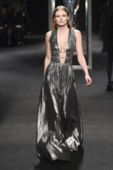 Edita Vilkeviciute models a metallic plunging gown for the Alberta Ferretti Fall 2018 RTW collection