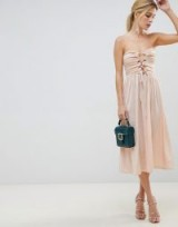 ASOS DESIGN bandeau slinky cut out midi dress in Blush | strapless front lace-up party frock