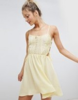 ASOS DESIGN Broderie Tie Side Beach Dress in yellow | strappy sundress