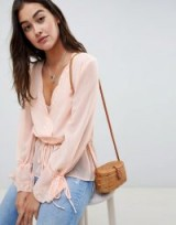 ASOS DESIGN sheer wrap top with lace trims in pink