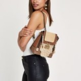 River Island faux fur lock front backpack | neutral tone backpacks