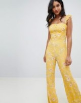Flynn Skye bloom print jumpsuit in touch of honey | yellow floral ruffle strap jumpsuits