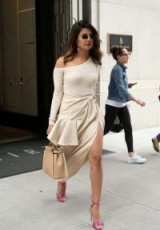 Priyanka Chopra wearing a summery beige outfit with pink strappy sandals, out in NYC, June 2018 – celebrity street style