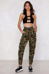 Nasty Gal Action Woman Camo Pants in Khaki | cuffed camouflage trousers