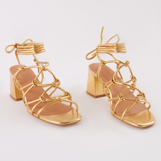 PUBLIC DESIRE FREYA KNOTTED STRAPPY BLOCK HEELED SANDALS IN GOLD – chunky metallic heels