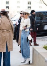Light blue denim dungarees, chunky ivory jumper and white accessories | casual street style