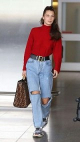 Bella Hadid casual style…ripped light denim jeans and red turtle neck.