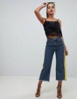 PrettyLittleThing cropped wide leg stripe side jeans in mid wash | frayed hems