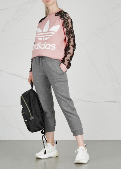 STELLA MCCARTNEY Pink Logo-print lace-trimmed sweatshirt / sheer floral sleeves