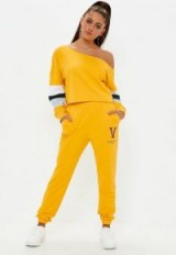 Missguided yellow virginia state jogger sweat bottoms – sports fashion