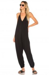 Bobi DRAPED JUMPSUIT in Black | plunge front | cuffed hems | relaxed fit