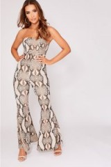 IN THE STYLE LINDSEY BROWN SNAKE PRINT BANDEAU FLARE LEG JUMPSUIT | retro going out fashion