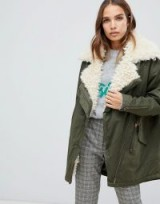 Only sheared lined parka jacket in green / faux fur lining