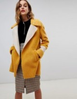 River Island longline borg boat in yellow | autumn tones