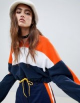 The Ragged Priest cropped fleece with half zip in orange – sporty colourblock top