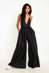 UO Gia Black Plunging Shimmer Jumpsuit | deep V-neckline | wide leg | thin straps