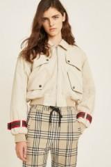 Andrea Crews Crop Trench Coat in Cream – cropped zip-up jacket