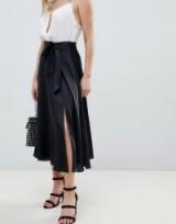 ASOS DESIGN Petite satin midi skirt with self tie in black | flowy front slit skirts
