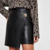 RIVER ISLAND Black button side wrap mini skirt | asymmetric hemline
