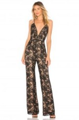 Chrissy Teigen X REVOLVE THAI SMILE JUMPSUIT in Black – plunging lace jumpsuits