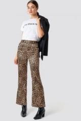 NA-KD Trend Flared Shiny Leo Pants Brown | animal print trousers