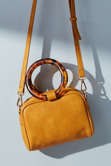 Anthropologie Lucite-Handled Crossbody Bag in Yellow / round tortoiseshell pattern top handle