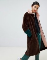 Na-kd faux fur midi colour block coat in brown | pink trim winter coats
