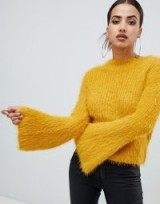 PrettyLittleThing flared sleeve fluffy jumper in yellow | wide sleeved sweater