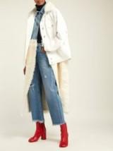 NATASHA ZINKO Shearling and denim hybrid coat