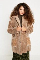 UO Faux Shearling Coat in Beige / light brown winter coats