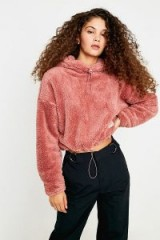 UO Fluffy Teddy Cropped Hoodie in Pink