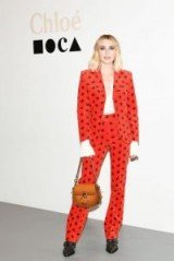Emma Roberts black buckled boots worn with a red printed trouser suit at the Chloe and Museum of Contemporary Art Dinner, 27 November 2018 – CHLOE Rylee Leather Lace Up Buckle Boots | celebrity footwear