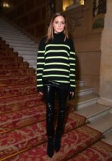 Olivia Palermo dressed in high shine skinny pants and a black striped turtleneck sweater, at the Balmain show during Paris Fashion Week, 29 Sept 2018 | style icon outfits