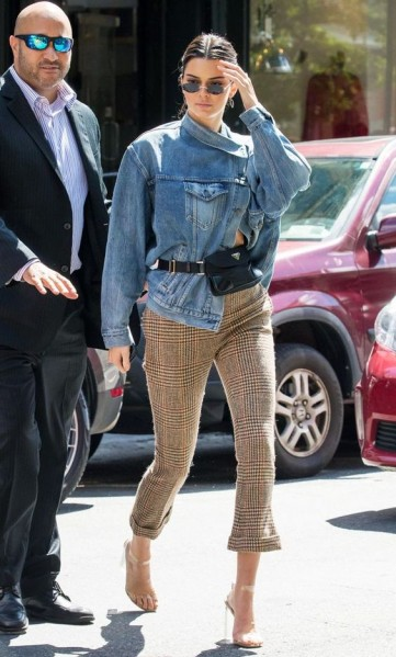 Kendall Jenner asymmetric denim jacket and cropped houndstooth pants | NYC street style