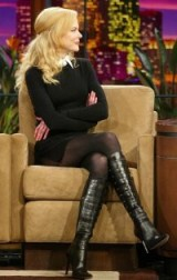Nicole Kidman wearing a pair of strappy front knee high boots