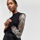 WAREHOUSE SEQUIN SLEEVE JUMPER in Black | glam party fashion