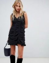 The East Order Paloma ruched mini dress in black | gathered slip dress
