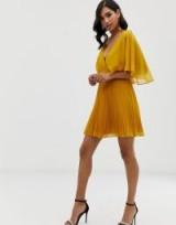 ASOS DESIGN flutter sleeve mini dress with pleat skirt in gold