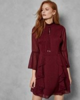 TED BAKER HALEAT Dobby ruffle skirt dress in maroon / high neck, flared sleeve party dresses