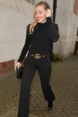 Miley Cyrus black double G waistband trousers, GUCCI GG trousers, out in London, December 2018 | celebrity fashion